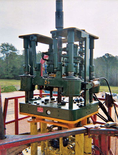  Figure 2: One model of the snubbing tong is jack-mounted. 