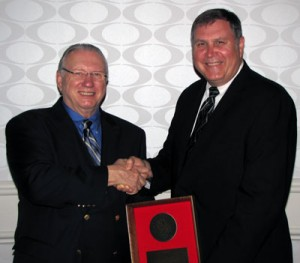 IADC president Dr. Lee Hunt (left) with Jim Gormanson, Director of Compliance, Noble Drilling Services Inc. (right).