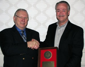 "IADC president Dr. Lee Hunt (left) with William P. ""Bill"" Hedrick, Vice President Claims Management & Special Projects, Rowan Companies (right)."