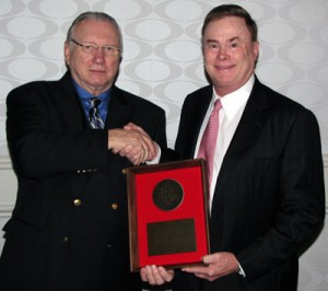 "IADC president Dr. Lee Hunt (left) with James M. ""Jim"" Nicklos, President, Nicklos Drilling Company (right)."