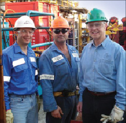 Jim Nowotny (from left) in his role as the Atwood Eagle operations  manager; Jason Johns, lead roustabout; and John Irwin, former Atwood  president/CEO, work on the Atwood Eagle semi.