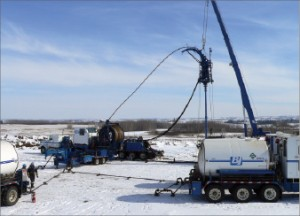 A coiled-tubing winter operation is carried out near Red Deer, Alberta, Canada.