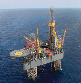 """The Gilbert Rowe (left) is one of two jackups that Rowan currently  has in the Middle East working for Maersk Oil. """"The wells we're  drilling in Qatar for Maersk – we essentially drill until the top drive  stalls. We're running those rigs at 100%,"""" said David Russell, the  company's executive vice president – drilling operations. The company  also has three jackups working for Saudi Aramco, including the Scooter  Yeargain (page 24)."""