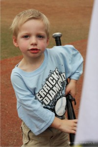 One of the bat boys at the tournament. All of the bat boys and bat   girls are former patients at Texas Children's Hospital.