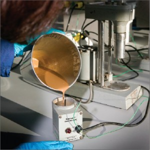  A lab technician uses a Fann Thermo-cup to quickly heat drilling fluid samples to test the viscosity of the fluid.