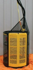 The DB-1 system features a cone-shaped aluminum basket weighing 105 lbs that is attached to an air tugger, a lifting device designed for light loads, at a single-point hookup. The basket provides outer protection for the worker and allows the tools to move with the worker.