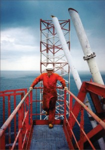 Frank Springett atop the derrick of the Santa Fe Monarch during summer 1994.