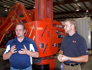 Craig Brooks (left), NOV drillfloor tools product line manager, and Brian Winter, NOV global product engineer, explain the features of the ST-120 iron roughneck during a demo for Drilling Contractor on 29 September in Houston.
