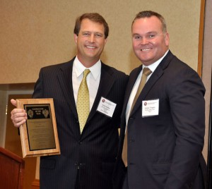 Scott Gordon, regional vice president of Unit Texas Drilling, accepting his 2010 IADC Contractor of the Year award from Jeremy Thigpen, National Oilwell Varco president downhole tools & pumping solutions.