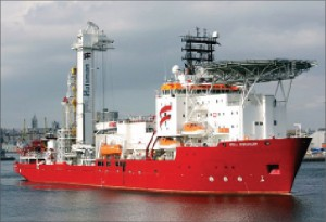 The monohull well intervention vessel Well Enhancer leaves the port of Aberdeen for a well intervention job in the North Sea. The ship features a well intervention multipurpose tower designed and built by Huisman.