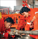 PetroVietnam Drilling workers prepare a wireline tool for deployment. In addition to operating six high-spec jackups, the company also works in partnership with other companies to provide oilfield services.