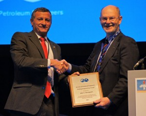 Left to right: 2011 SPE President Alain Labastie presents the 2011 SPE Drilling Engineering Award to Dr John Thorogood.