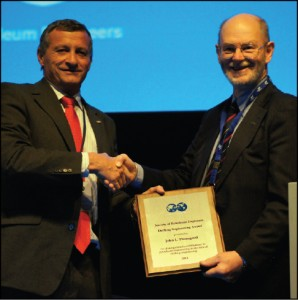 2011 SPE president Alain Labastie (left) presents the 2011 SPE Drilling Engineering Award to Dr John Thorogood on 2 March in Amsterdam.