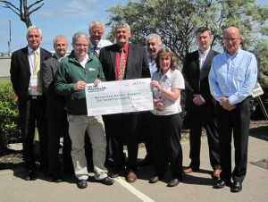 David Cameron (front left in green) of Macmillan Cancer Support accepts a donation check from representatives of the IADC North Sea Chapter: (from left) John Skeggs, Odfjell Drilling; Gary Holman, Archer; Jens Hoffmark, IADC; Glenn White, Rowan Drilling and NSC chairman; Dusty Miller, Diamond Offshore; Edit McLeod, NSC staff; Rob O'Neill, Workstrings International; and Martin Ellins, KCA DEUTAG.