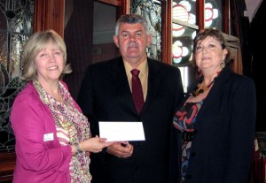 Glenn White, IADC North Sea Chapter chairman, presents a 4,400 check to CLAN chief executive Debbie Thomson (left). Mr White and Val Hood (right), NSC office administrator, were invited to CLAN's Aberdeen center so they could see for themselves how IADC's donation will make a difference.