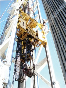Figure 3: During drilling operations, the top drive ergonomically reduces the number of manual connections needed. Courtesy of National Oilwell Varco