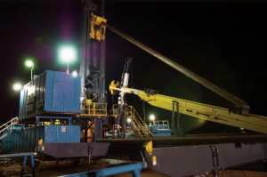 The Atlas Copco Predator rig handles a piece of casing with the automated pipe-handling tool. The pipe-handling element of the rig design is a key safety feature.