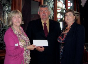 CLAN chief executive Debbie Thomson (left) receives a £4,400 check from Glenn White (center), IADC North Sea Chapter chairman, and Val Hood, NSC office administrator.