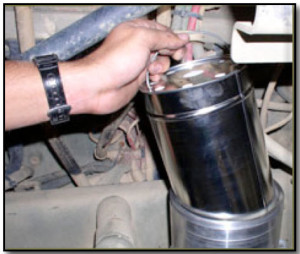 Figure 3: The disposable filter element of the bypass system is replaced during the scheduled oil drain interval when the oil sample is taken.