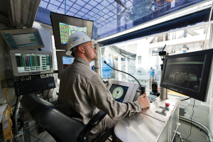A driller sits inside the driller's cabin on an advanced-technology rig. Mechanization is extensive on the advanced rigs Oxy uses, though automating complex tasks is not a specific goal for the company.