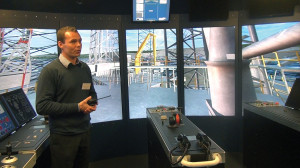 Michael Toftelund, Maersk Training Svendborg maritime instructor, explains the functions of the rig control room simulator at the MOSAIC II. The simulator allows students to test their ability to apply knowledge they've learned in the classroom before going back into the workplace.