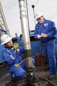 Schlumberger engineers inspect the iPZIG tool prior to drilling in a North American shale play. The service features an azimuthal gamma ray and an inclination measurement behind the bit to give an indication of the BHA position relative to the formation. Photo courtesy of Schlumberger