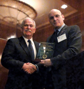 On behalf of the IADC Jackup Rig Committee, David Lewis (left) of Lewis Engineering Group accepts the award from the association's president and CEO Stephen Colville in Houston on 5 February.
