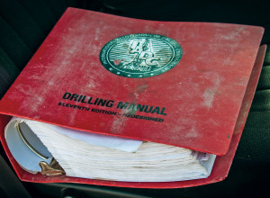 A well-used 11th-edition of the IADC Drilling Manual sits on the front seat of a truck at a wellsite in the Permian Basin. IADC plans to issue the new 12th edition in 2014 in both print and digital formats; the latter will incorporate videos and animations.