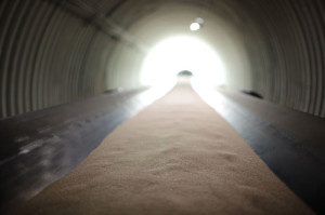 A conveyor belt transports sand before it is coated with Preferred Sands' non-phenolic resin technology.