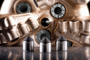 Figure 1: The conical diamond element (foreground), centrally placed in a PDC drill bit cutting structure, increased ROP by more than 46% for one Bakken operator.