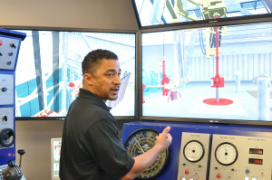 Paul Kilchrist, drilling and well control adviser, demonstrates the capabilities of the conventional drilling simulator during a DC-exclusive tour of the Noble NEXT Center in September.