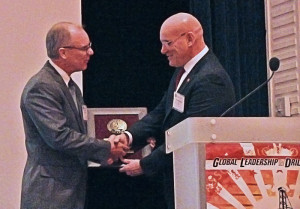 Terry Loftis accepts the IADC Exemplary Service Award for innovation and contributions to the ART Drilling Control Systems Subcommittee from Stephen Colville, IADC president and CEO.