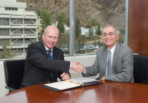 Lars Hoier (left) senior vice president, research, development and innovation for Statoil, and Dr Charles Elachi, director, NASA/JPL-Caltech, seal the partnership agreement to study how technologies and expertise from the space industry can benefit the oil and gas industry as it pushes into new frontier regions, such as the Arctic.