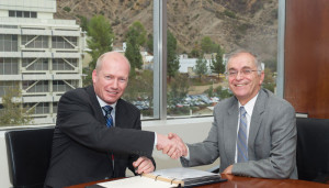 Lars Hoier (left), senior vice president, research, development and innovation at Statoil, and Dr Charles Elachi, NASA Jet Propulsion Laboratory director, seal the partnership in 2013.