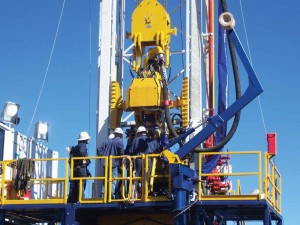 An Easternwell rig crew operates one of three Advantage Series coal seam gas rigs drilling in the Surat Basin near the township of Roma, 400 km west of Brisbane in Queensland.