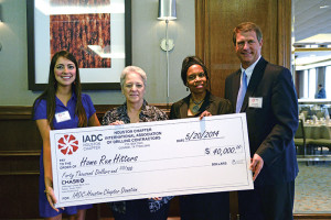 The IADC Houston Chapter presents a check to Home Run Hitters International for $40,000. From left are Allison Fraser, Rowan; Marcy Sandell, mother of a Home Run Hitters student; Dr Deborah Carr, Home Run Hitters; and Scott Gordon, Derrick Equipment.