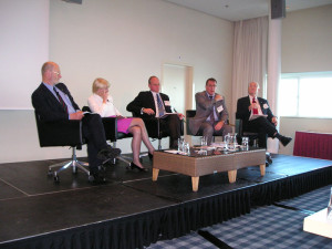 Joe Hurt (right) moderates a panel session at the 2011 IADC Drilling HSE Europe Conference focused on organizational culture and process safety.