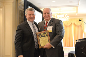 Independence Contract Drilling's Ed Jacob (right) accepts the 2014 IADC Contractor of the Year award from National Oilwell Varco CEO Clay Williams.