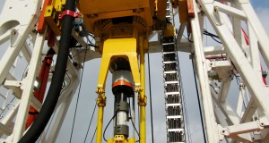 GDS' Global Drilling Machine top drive system working in an Orion Drilling mast.