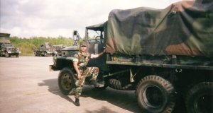 Abel Esquivel stands next to a vehicle at the Naval Air Station Joint Reserve Base New Orleans. Mr Esquivel was a petty officer first class in the US Navy and a veteran of the Gulf War era. His injuries, including single-sided deafness and a double lower spinal cord injury, ended his military career in 2005. He is now working as a proctor for IADC WellSharp tests.