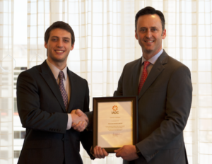IADC President Jason McFarland (right) presented Corey Wittig, a senior at Texas A&M University and Chairman of the A&M Student Chapter, with a certificate of organization for the chapter. The chapter will hold its first meeting on 13 February on the A&M campus.