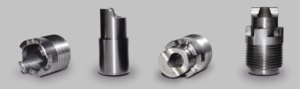 Varel's curved nozzle design redirects the fluid flow so that the bottom-hole impact point is moved farther out toward the shoulder of the bit.