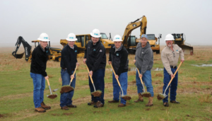 Newfield Exploration Company employees break ground on a water recycling facility in Kingfisher County, Okla.