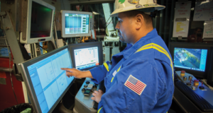 A driller on Precision's Rig 601 sets parameters for the Process Automation Control system. When the system was run in a pilot program in the Permian Basin, it improved connection times by 30% compared with a driller executing the process manually.