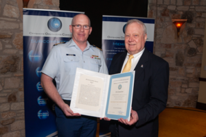 Captain Josh Reynolds (left) of the US Coast Guard presents IADC's Alan Spackman (right) with a Meritorious Public Service Award at the Offshore Operators Committee 70th Anniversary General Meeting in Austin, Texas, on 6 June. The Coast Guard presented Mr Spackman with this award in recognition of the work he has done to improve safety, security and the environment on the US Outer Continental Shelf.