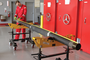 A technician measures the total length of pipe with the Halliburton Swellpacker isolation system attached. The system has self-healing elastomers that swell when contacting oil or water in both cased and open holes.
