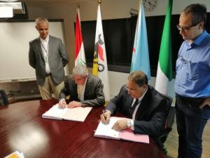 Halliburton Vice President of Iraq Mahmoud El-Kady (pictured right) signs two drilling services contracts with ENI's Managing Director Massimo Insulla (pictured left).