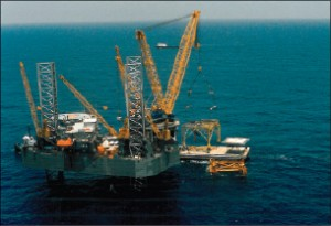 During Mr Palmer's career, Rowan conducted a crane business called Terminator Inc. This photo shows the Rowan New Orleans using one of the company's 550-ton cranes for removing offshore structures.