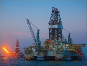 """The Development Driller II drilling rig and Discoverer Enterprise drillship at the MC252 site, Gulf of Mexico on 10 June. As of 28 June, the first relief well, which started drilling 2 May, has reached 16,546-ft MD and has completed a second """"ranging"""" run using specialist equipment inserted into the well to help more precisely locate the MC252 well. Drilling and ranging operations will continue over the next weeks as the well progresses toward the target intercept depth of approximately 18,000 ft. The second relief well, which started 16 May, is at 12,038-ft MD. Both wells are still estimated to take approximately three months to complete from commencement of drilling. (Source: BP)"""