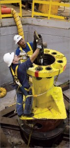 """Test pipe was distorted to resemble what is reasonably expected to be at the deepwater site. During the night shift, the flanged """"mule shoe"""" transition spool assembly was prepared for systems integration testing at Oil States Industries' high-bay fabrication unit in Houston in June 2010. Source: BP.com"""
